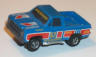 Tomy GMC devils ditch pickup truck, blue with red, white, and yellow #57