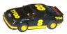 Tyco Ford T-bird stocker in black with red and yellow #8