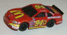 Tyco '99 Taurus in red with yellow #94 McDonalds sponsor